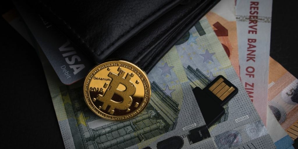 bitcoin some cash and a wallet by aleksi raisa