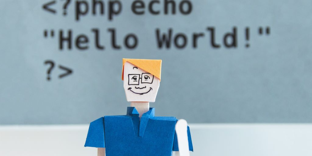 paper doll in front of code by kobu agency
